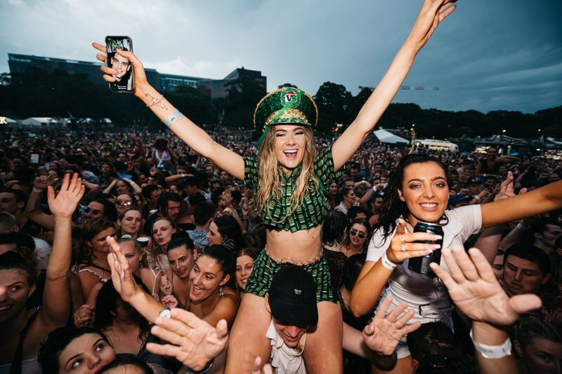 Photo of lady on shoulders at NYE in the Park